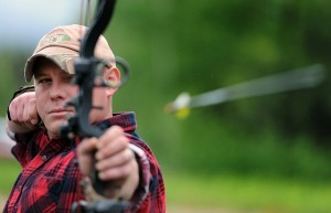 A recurve bow, with sights, in action